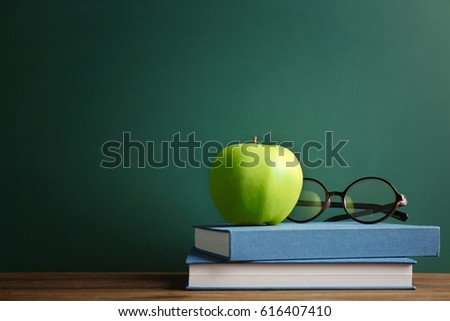 books and apple on chalkboard...