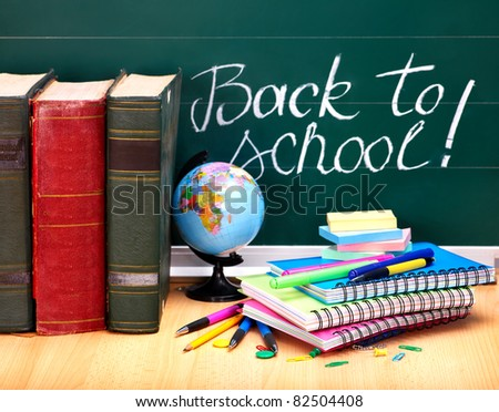 Books and blackboard. School supplies.. Back to school.