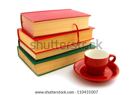 Books and coffee cup isolated on white. Back to school concept.