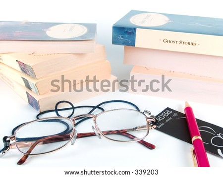 Books and glasses against white background
