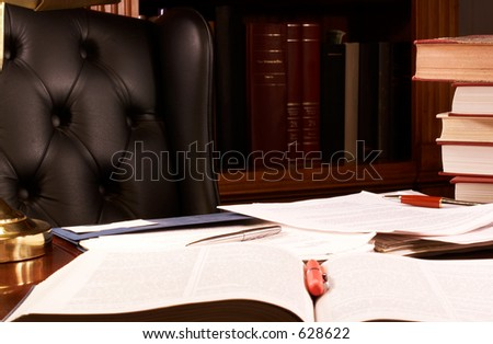 Books and papers piled on a desk
