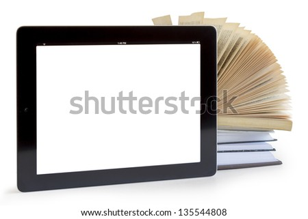 Books and tablet computer isolated on white, digital library concept,
