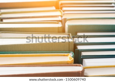 Books and textbooks in hard tissue cover. Education and science concept.