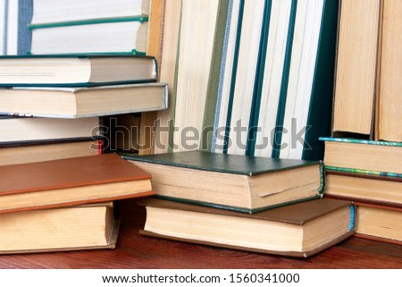 Books and textbooks on a shelf in the library. Education concept