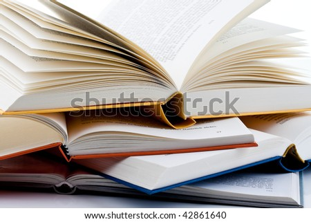 Books are set up on a white background - stock photo