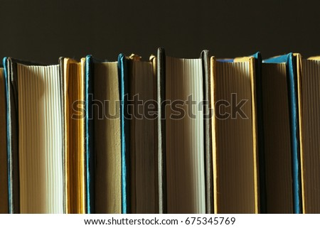 Books Close Up On Old Wooden Table 675345769