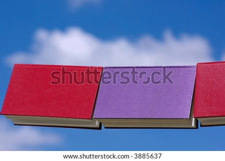 Books displayed with the blue sky in deep.