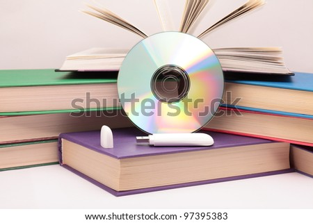 Books, flash drive and CD.