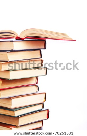 Books in a row. Isolated on white background
