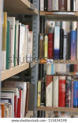 Books in public library, shallow DOF