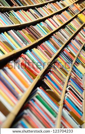 Books in round library shelf #123704233