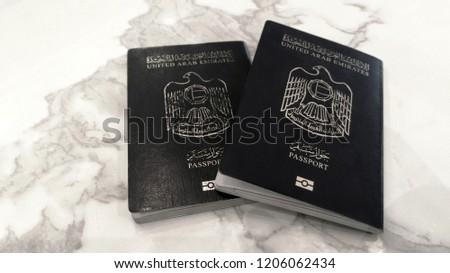 Books of United Arab Emirates Passport on marble texture background
