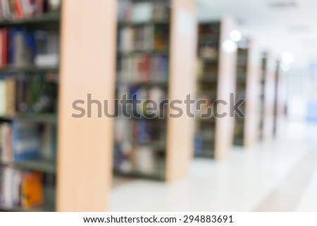 books on bookshelf in library, abstract blur defocused background