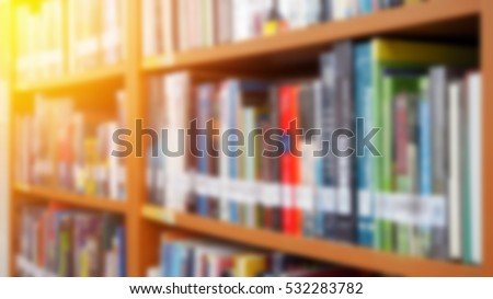 Books on bookshelf in library room, abstract blur de focused background