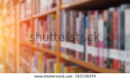 Books on bookshelf in library room, abstract blurred focused background,