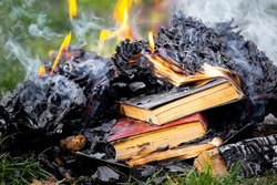 Books on fire, burning books as an illustration of ignorance