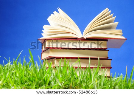 Books on grass.