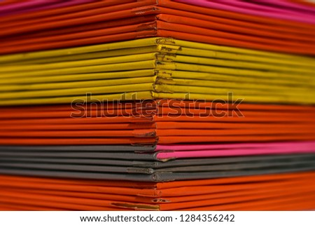 Books or multicolored document files overlapping multiple colors #1284356242