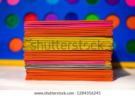 Books or multicolored document files overlapping multiple colors #1284356245