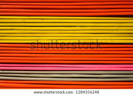 Books or multicolored document files overlapping multiple colors #1284356248
