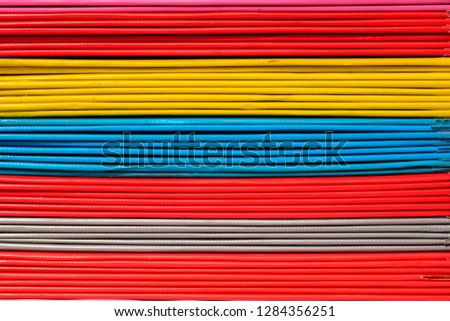 Books or multicolored document files overlapping multiple colors #1284356251