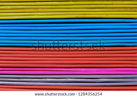 Books or multicolored document files overlapping multiple colors #1284356254