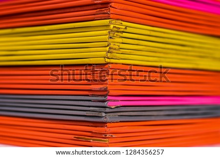 Books or multicolored document files overlapping multiple colors #1284356257