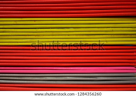 Books or multicolored document files overlapping multiple colors #1284356260