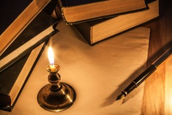 Books, paper, candle and pen