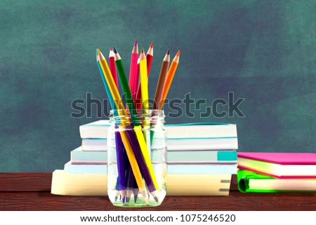 Books ,pen,pencil and office equipment on blue background, education and back to school concept,Clipping path #1075246520