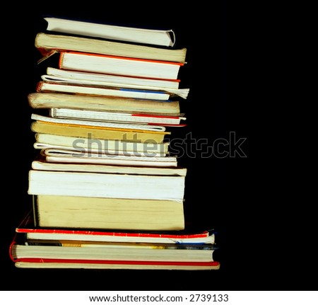 Books pile isolated on black with empty, editable space