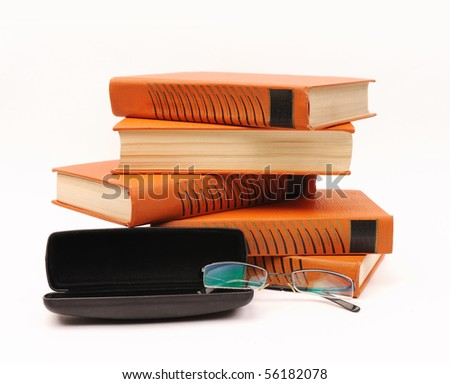books stack and glasses isolated on white background