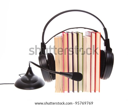 Books stack and headset with a microphone isolated on white