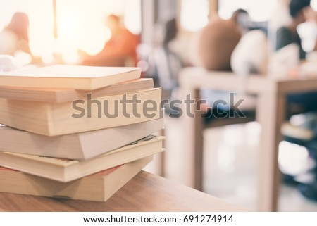 books stack on the library table. At the time of university student exams in selective focus.