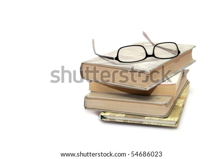 books stack with eyeglasses