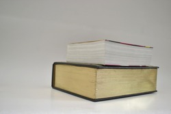Books, thick big and small in photo with selective focus on color photography