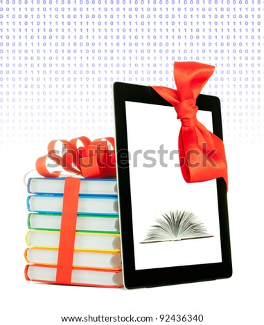 Books tied up with ribbon and tablet PC against white background