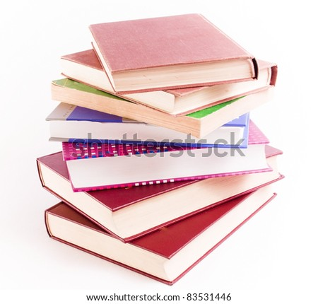 Books tower over white background - education concept - stock photo