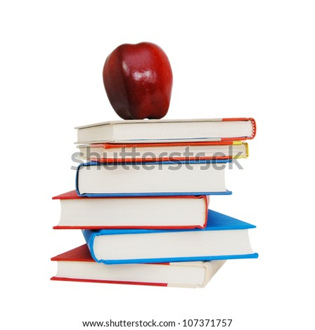 books with a big red apple isolated on white background