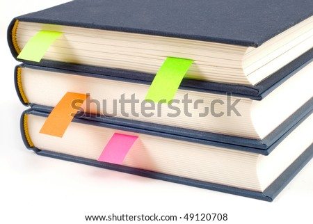 Books with bookmarks isolated on white background