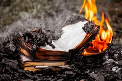 Books with burned pages as an illustration of ignorance