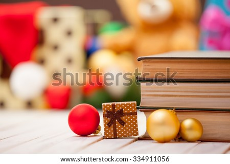 Books with christmas gifts on background