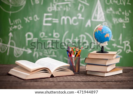 Books with globe on the school desk