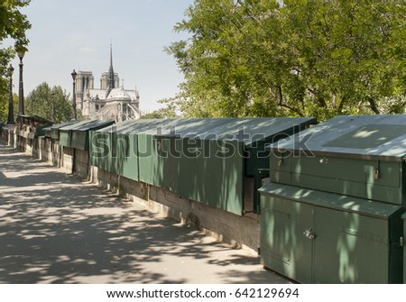 Bookstores by the Seine river in Paris with Notre Dame church in the background stock photo
