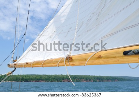 Boom and Foresail of Schooner Sailboat on a Sunny Summer Day