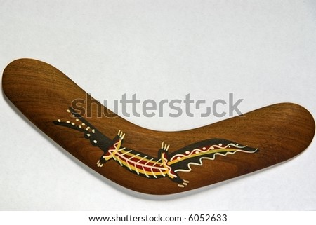 Boomerang with crocodile painting, isolated