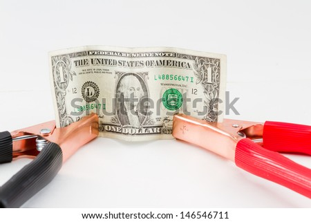 booster cables attached to a american dollar bill on a white background