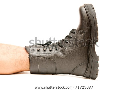 Boot on the foot isolated on white background