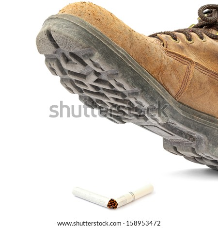 Boot steps on a broken cigarette isolated on the white background