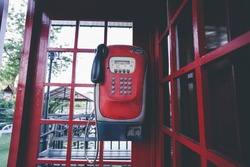 Boothphone red and telephone public payphone  in Thailand.